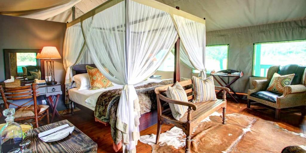 Suites feature a colonial theme with 4-poster beds draped with mosquito nets