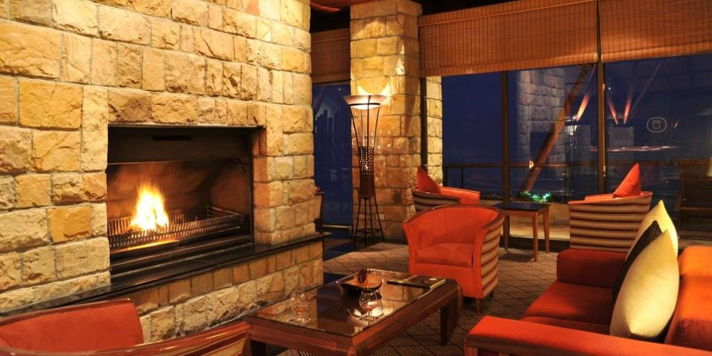 The fireplace provides the perfect ambience to the Cigar Lounge at Arabella
