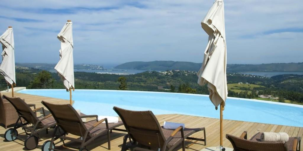 The swimming pool offers superb river views