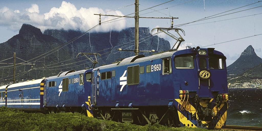 The Blue Train against the cloud topped Table Mountain in Cape Town
