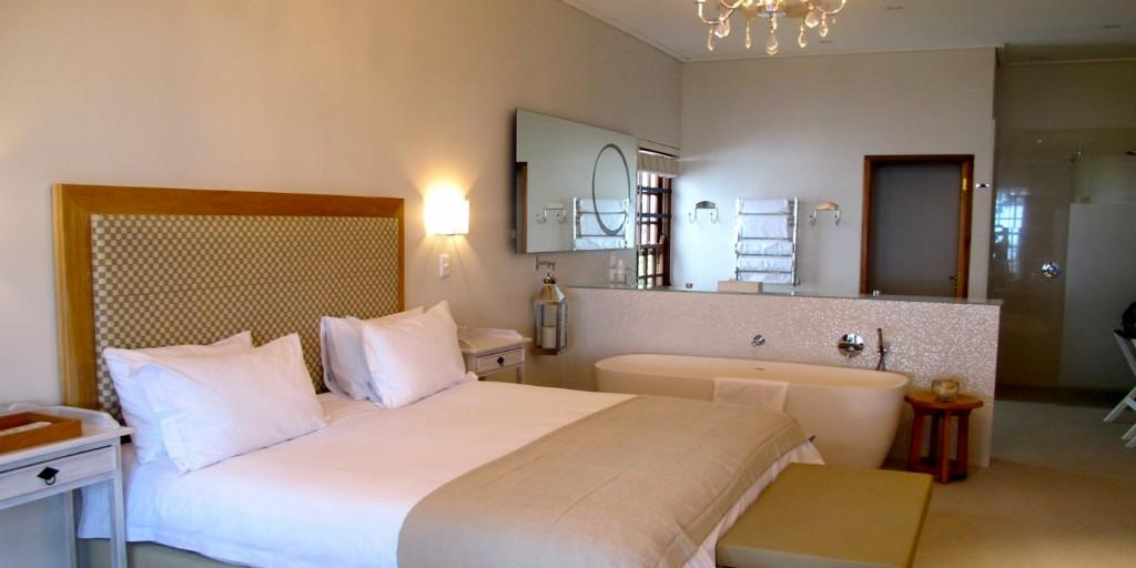 Luxury Rooms at Harbour House feature en-suite, open-plan bathroom with separate bath and shower